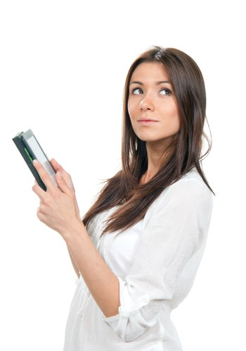 Business woman reading ebook device and looking